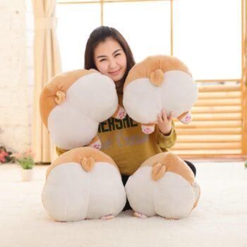 woman with 4 corgi butt plush toys