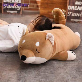 Woman Sleeping on a Giant Shiba Inu Plush