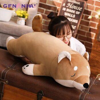 Sleeping Brown Shiba Inu Plush in a table