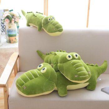 three kawaii alligator stuffed toy in a sofa