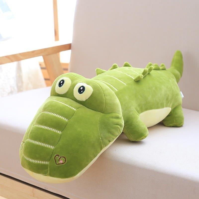 kawaii alligator stuffed toy in a sofa