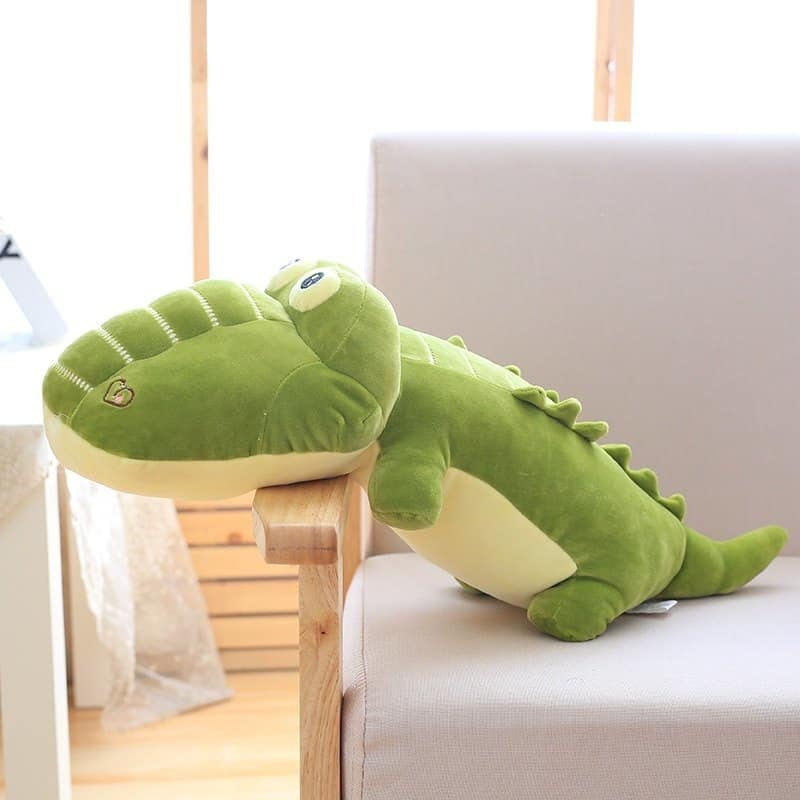 kawaii alligator plush pillow in a sofa