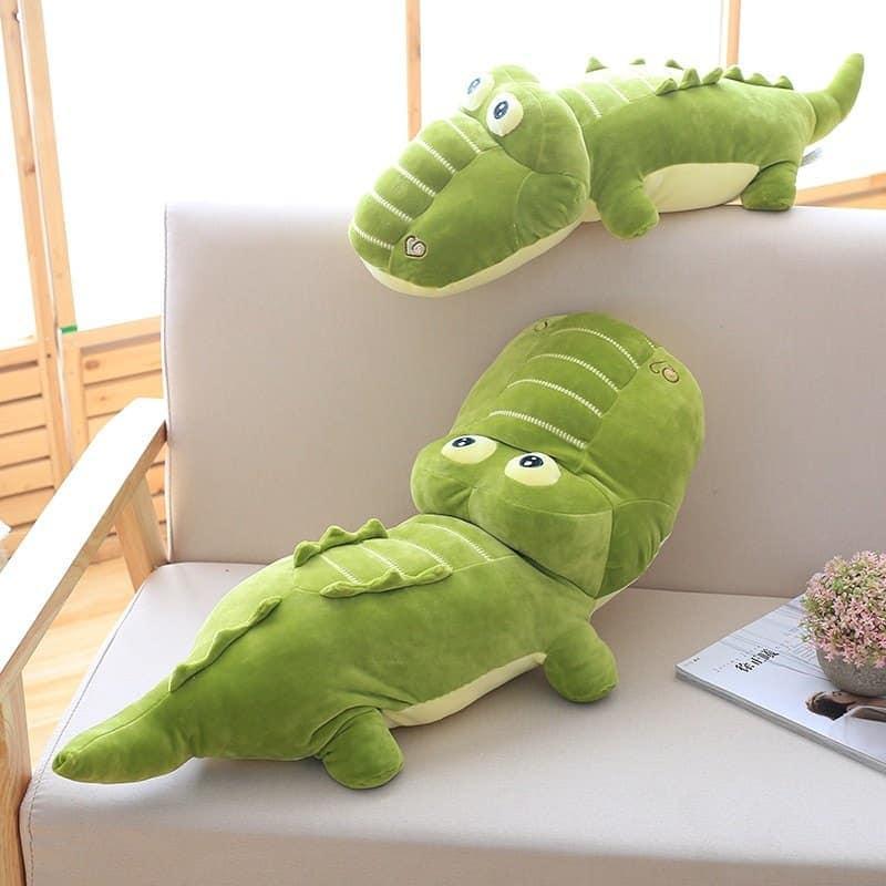 two kawaii alligator stuffed pillow in a sofa