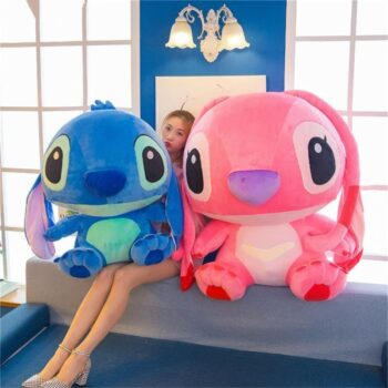 woman sitting in between angel and stitch plush pillow
