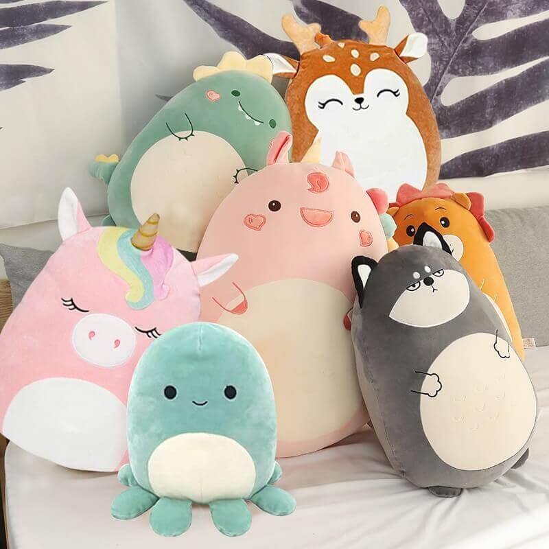 Multiple Kawaii Squishmallows plush pillows in a sofa