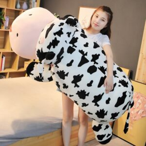 Woman Holding a Giant Cow Stuffed Animal
