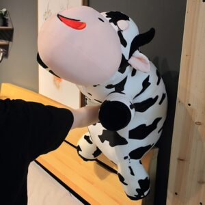 Woman Punching a Giant Cow Stuffed Animal