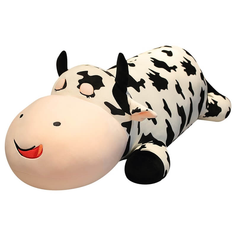 Lying Giant Cow plush in a white background