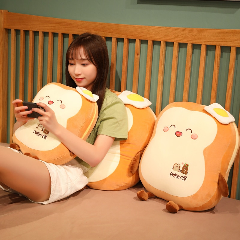 Woman holding a phone while sitting on a Kawaii Japanese Loaf Bread Plush