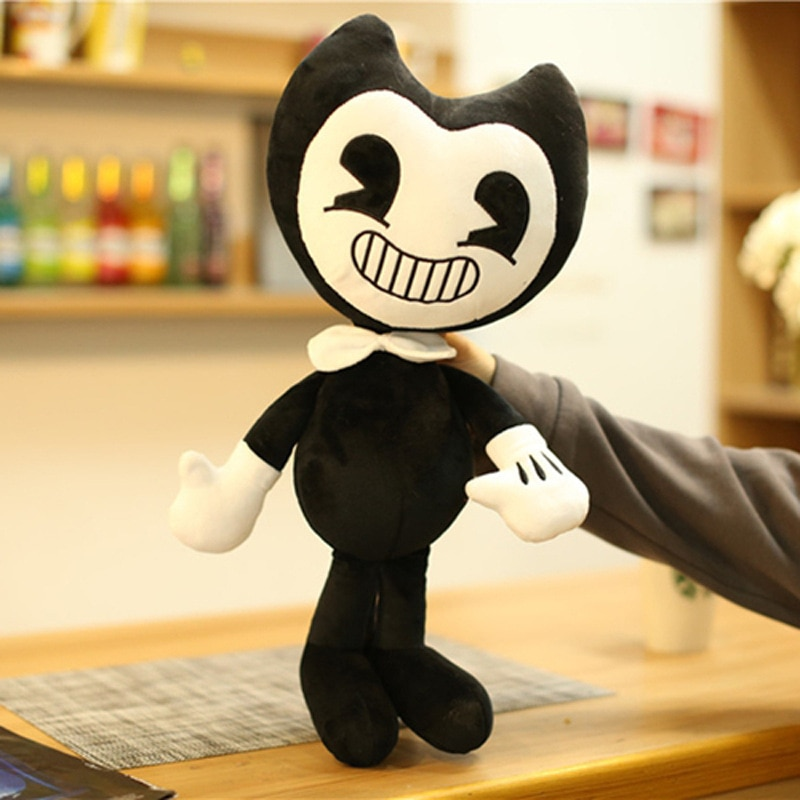 two Bendy Plush Toy being held by a hand
