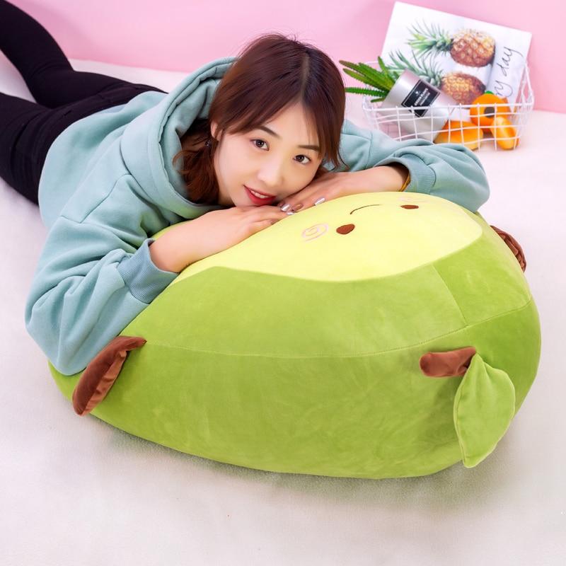 Woman lying on a Giant Avocado Plush
