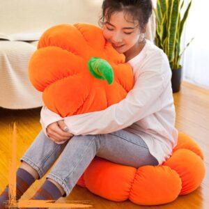 Woman sitting while hugging a Plush Pumpkin